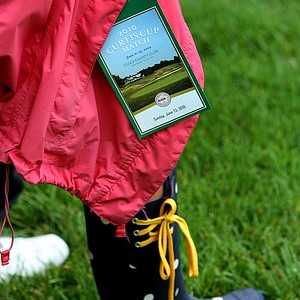 A spectators attire required rain boots during the singles matches of the 2010 Curtis Cup.