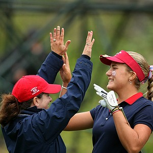 Team USA's Alexis Thompson, right, and Team Manager Donna Mummert celebrate clinching the first point during the singles matches. Thompson beat Sally Watson 6 and 5.