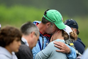 GB&I's Sally Watson is consoled by her father Graham after she lost to Alexis Thompson 6 and 5.