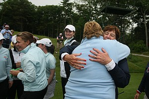 Team USA captain Noreen Mohler and GB&I captain Mary McKenna embrace after the singles matches.