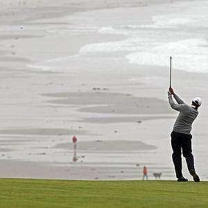 Arjun Atwal hits from the ninth fairway Monday at Pebble Beach.