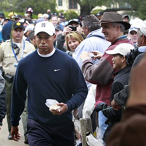Tiger Woods walks past a line of fans during Monday's practice round at the U.S. Open.