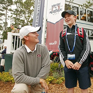 University of Georgia player Russell Henley poses with Jeffrey Aronson after the 13-year-old carried Henley's bag during Monday's practice round at the U.S. Open.