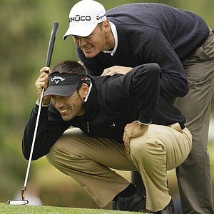 Alvaro Quiros and Martin Kaymer read a putt during the Tuesday practice round at the U.S. Open.