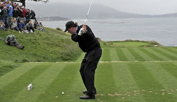 Phil Mickelson tees off on the par-3 seventh hole on June 15.