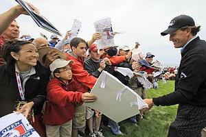 Phil Mickelson signs autographs for fans at Pebble Beach.