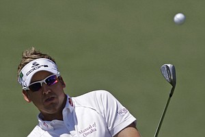 Ian Poulter sports a white shirt and purple tartans.