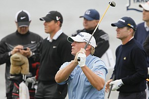 Steve Stricker hits a shot at Pebble Beach's eighth hole during a practice round.