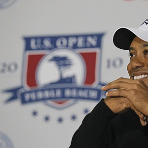 Tiger Woods answers questions after his Tuesday practice round.