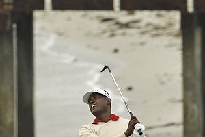 Vijay Singh hits a shot at Pebble Beach.