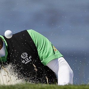 K.J. Choi blasts out of a bunker during Wednesday's practice round at the U.S. Open.