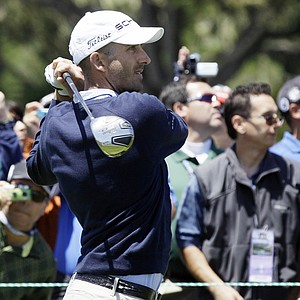 Geoff Ogilvy tees off in front of a crowd of spectators at Pebble Beach.