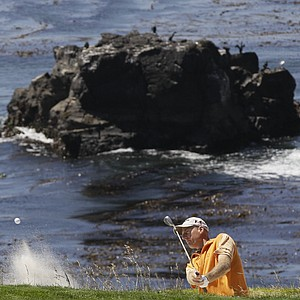 Jim Furyk blasts out of a bunker at Pebble's eighth hole.