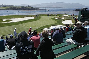 Fans watch players come through the 17th hole during the final practice round before the U.S. Open.
