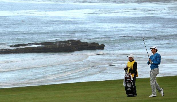 Rafael Cabrera-Bello hits his approach into the 10th hole Thursday at Pebble Beach.