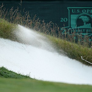 Gary Woodland found a bunker at the first hole.
