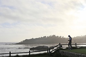 Hudson Swafford finishes his round in fading sunlight at Pebble Beach.