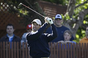 Padraig Harrington tees off at the 15th.