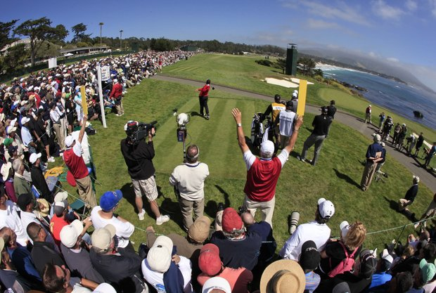 Sergio Garcia tees off in front of a crowd at the ninth tee.