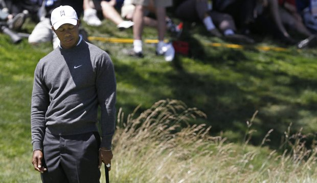 Tiger Woods watches a putt during the first round of the U.S. Open.
