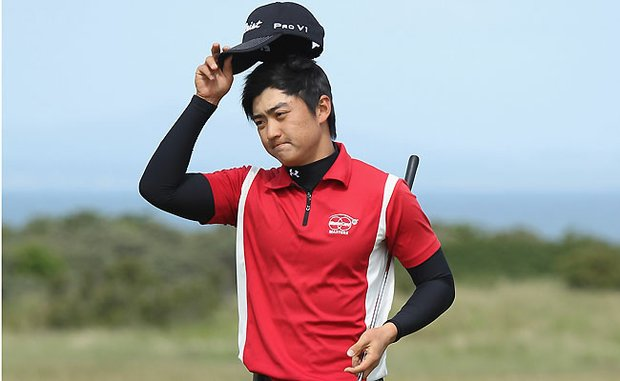Jin Jeong of Korea acknowledges the crowd after winning his quarter-final match against Paul Cutler of Northern Ireland during the Amateur Championship at Muirfield Golf Club on June 18, 2010.
