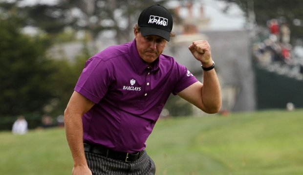 Phil Mickelson pumps his fist after making birdie on the 11th hole Friday at the U.S. Open.