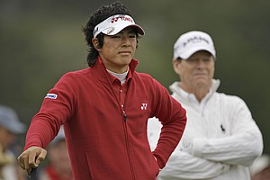 Ryo Ishikawa, 18, and Tom Watson, 60, wait on the third hole Friday at Pebble Beach.