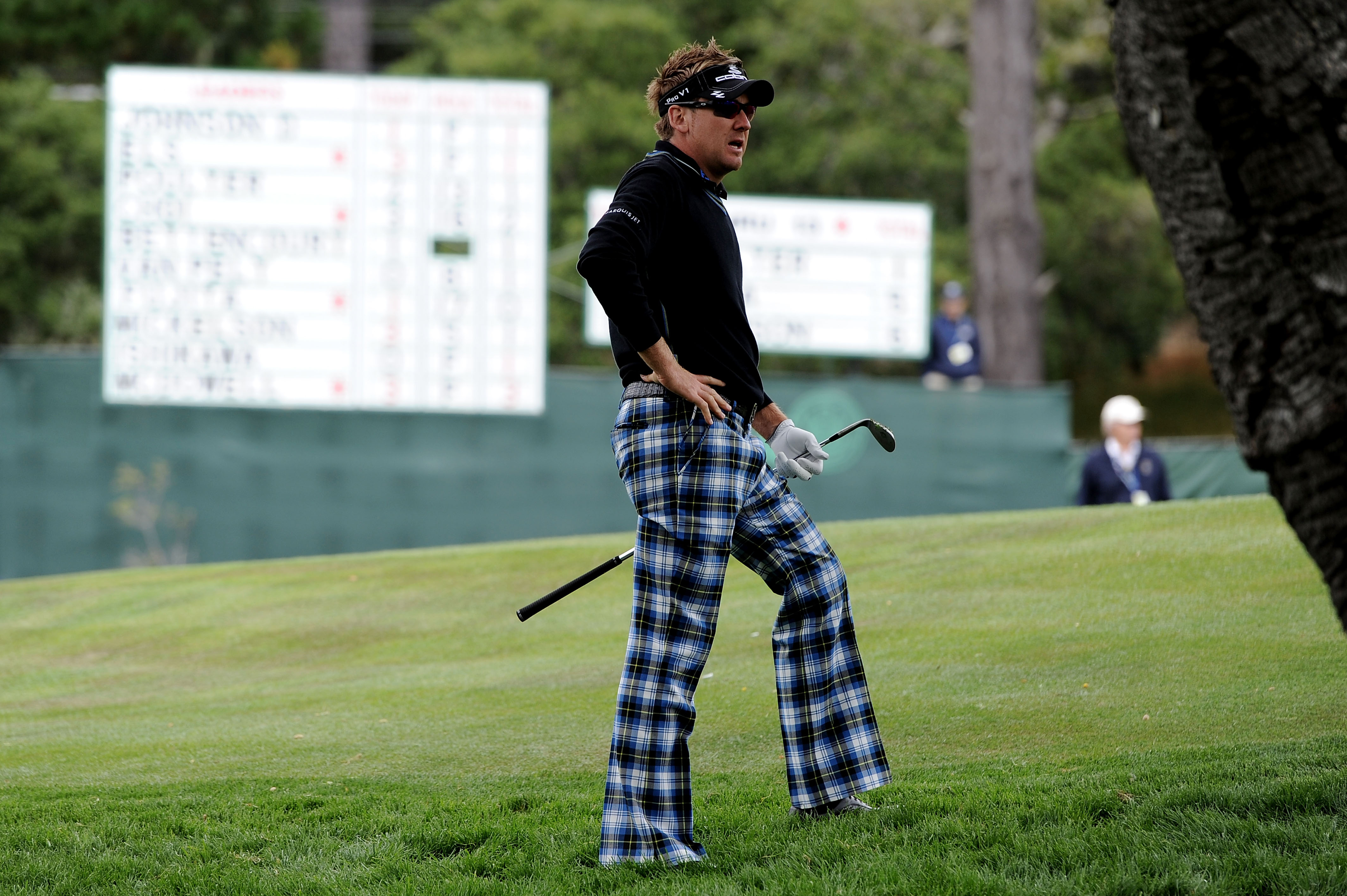 Ian Poulter reacts to his second chip at the par-5 14th hole Friday.