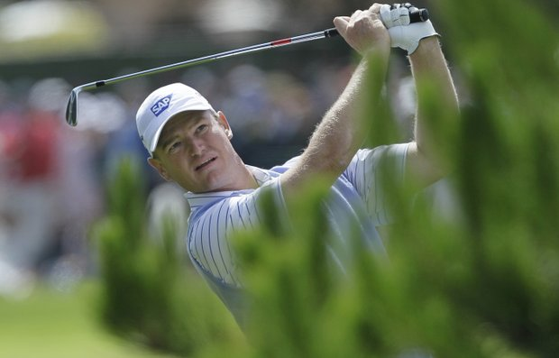 Ernie Els hits a shot at the first hole.