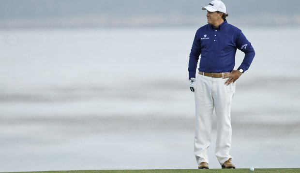 Phil Mickelson stands over a shot on the eighth hole Saturday at Pebble Beach.