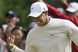 Tiger Woods reacts after birdieing the 16th hole Saturday at the U.S. Open.