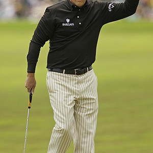 Phil Mickelson reacts after a birdie putt on the first hole.