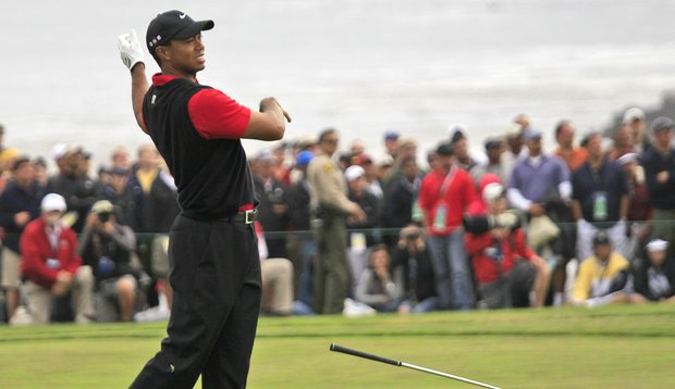 Tiger Woods drops his club after hitting a shot during the final round of the U.S. Open.