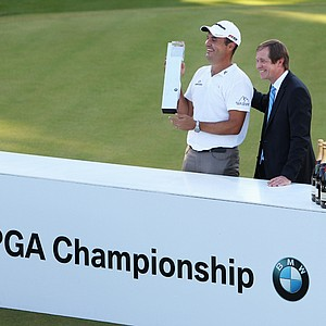 Simon Khan accepts the trophy from George O'Grady, European Tour chief executive, at the 2010 BMW PGA Championship. Europe's top players haven't always supported the BMW PGA Championship, the Euro Tour's flagship event.