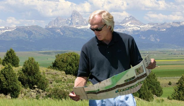 Greg Norman is shown reviewing plans for the stalled project at River Rim Ranch in Teton County, Idaho.