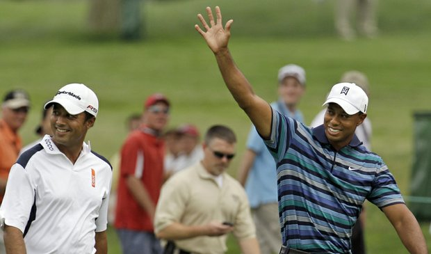 Tiger Woods (right) and Arjun Atwal play a practice round at the AT&T National on June 29.