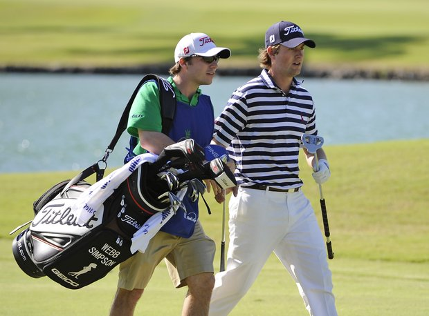 Webb Simpson and caddie William Kane during the first round of the Sony Open.