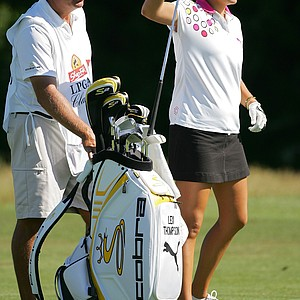 Alexis Thompson with her father/caddie, Scott, during her pro debut June 18 at the ShopRite LPGA Classic.