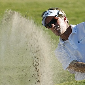 Brett Quigley has former NHL star Adam Oates on the bag at the AT&T National. (file photo)