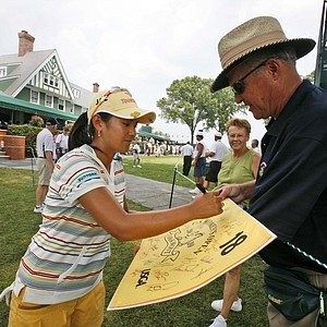 Ai Miyazato signs a autograph during a practice round for the U.S. Women's Open.