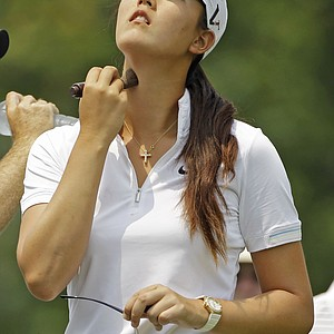 Michelle Wie powders her face before teeing off for practice round at the U.S. Women's Open.
