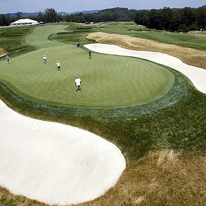 Players putt out on Oakmont's 14th green during a practice round for the U.S. Women's Open.