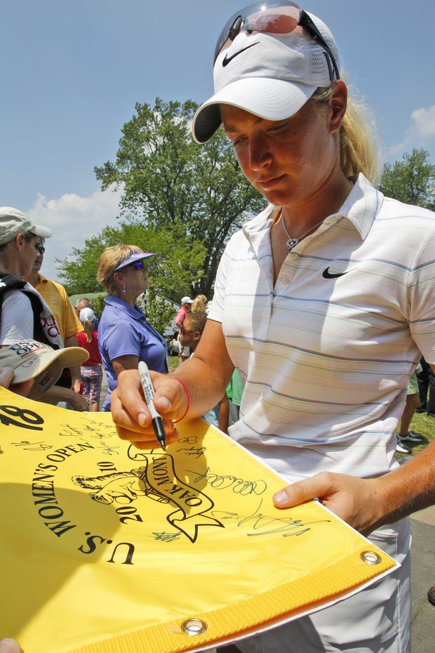 Suzann Pettersen signs autographs following a practice round at the U.S. Women's Open.