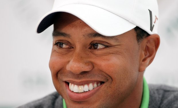 Tiger Woods smiles during a press conference after playing in the JP McManus Invitational Pro-Am.