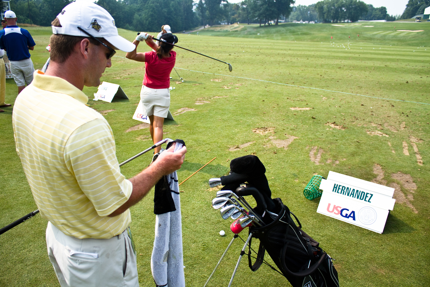 Greg Robertson (left) and Maria Hernandez on the practice range at Oakmont.