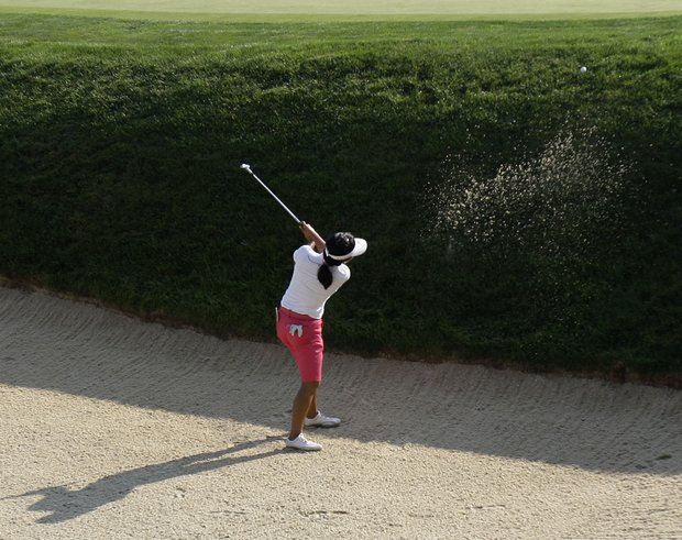 Jenny Shin hits out of a bunker on the 17th hole during a practice round for the U.S. Women's Open.
