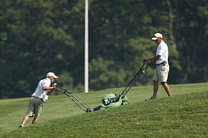 Members of the Oakmont grounds crew prepare the course during a practice round for the U.S. Women's Open.