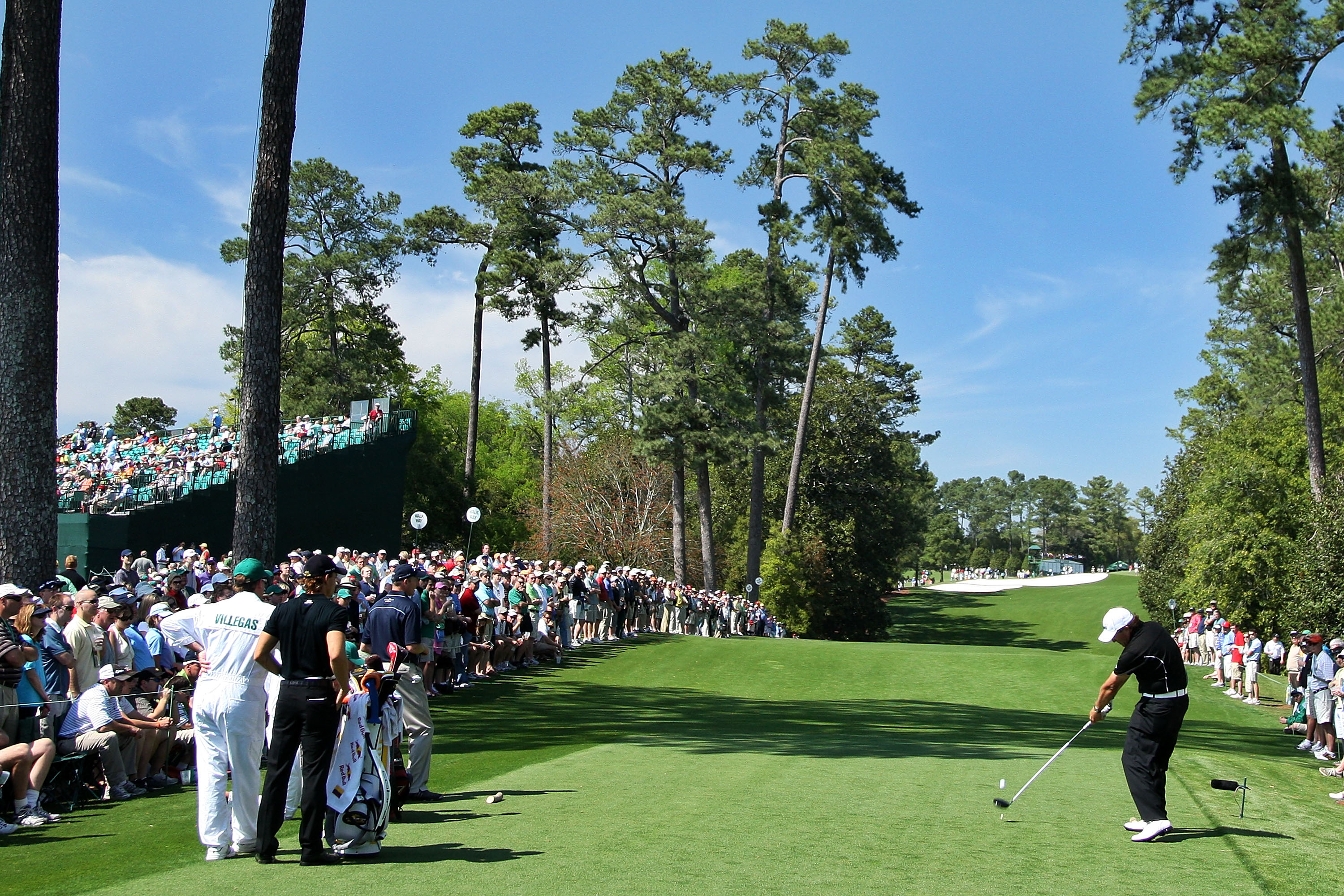 Phil Mickelson hits his tee shot on the 18th hole during the first round of the 2009 Masters.