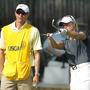 Suzann Pettersen talks with her caddie, David Brooker, during a practice round for the U.S. Women's Open.