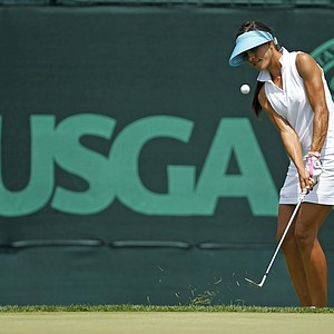 Veronica Felibert chips to the 10th green during a practice round for the U.S. Women's Open.